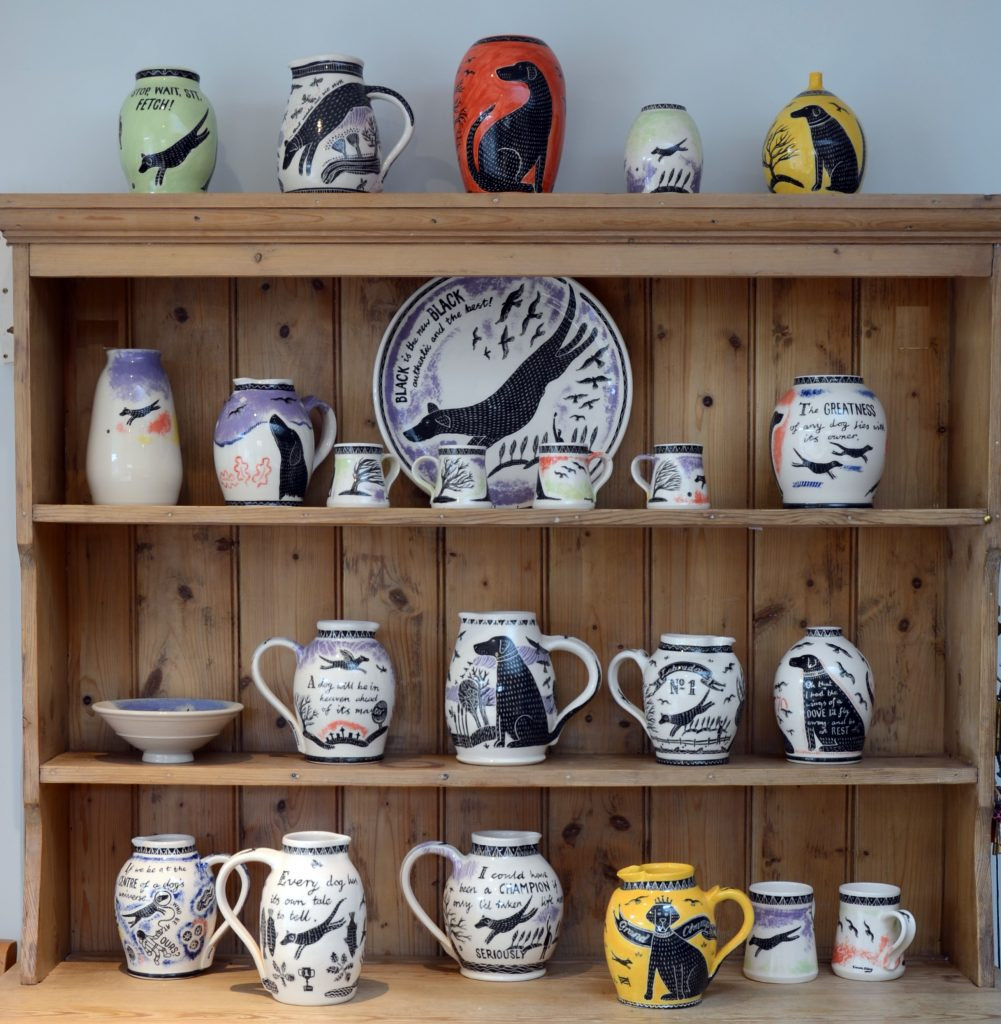 Olley Pottery is selling original ceramics online with Etsy - this image shows a dresser with a display of Olley Pottery's original work